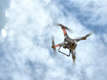 Quadrocopter. On blue sky background Royalty Free Stock Photography