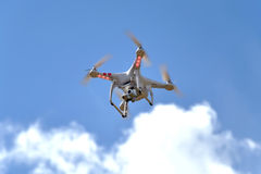 Quadrocopter. On blue sky background Stock Images