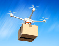 Quadrocopter with cardboard package Stock Photography