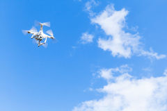 Quadrocopter, compact drone in cloudy sky Stock Photography