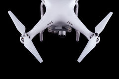 Quadrocopter, copter, drone. Unmanned aerial vehicle, drone on isolated background, quadrocopter designed for photo and video shooting. White quadrocopter camera royalty free stock photo
