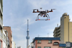 Quadrocopter drone in city. Quadrocopter drone fling in city Royalty Free Stock Photography