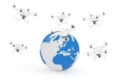 Quadrocopter Drones Flying Near Earth Globe. 3d Rendering. Quadrocopter Drones Flying Near Earth Globe on a white background. 3d Rendering Royalty Free Stock Image