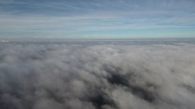 Quadrocopter flies over the clouds. stock video