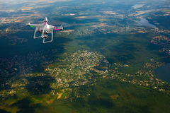 Quadrocopter flying over farmland Royalty Free Stock Photo