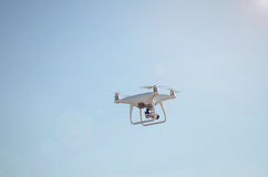 Quadrocopter Hovering In Blue Sky Royalty Free Stock Photos