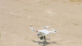 Quadrocopter landing, modern spy technology for surveillance, drone with camera. Stock footage stock footage
