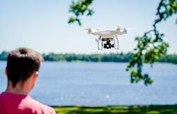 Quadrocopter. With photo camera flying outdoors Royalty Free Stock Image