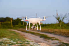 Quadrocopter on roads and background trees Stock Images