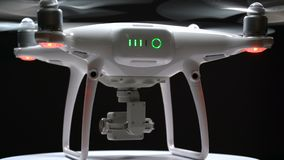Quadrocopter rotates on the turntable. Close up stock footage