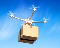 Quadrocopter z kartonowym pakunkiem Fotografia Stock