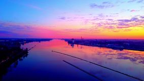Quadrocopter above river. Drone flying above river in sunrise stock video