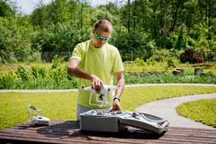Quadrocopters preparation for flight. Man preparation quadrocopters for flight in the garden royalty free stock photography