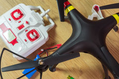 Quadrocopters, remote control, batteries, lie next to each other Stock Image