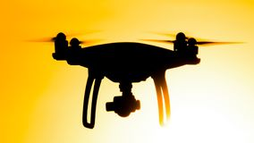 Quadrocopters silhouette against the background of the sunset stock photos