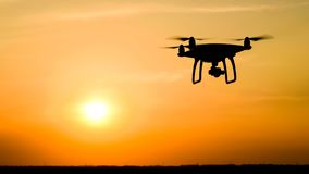 Quadrocopters silhouette against the background of the sunset royalty free stock images