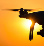 Quadrocopters silhouette against the background of the sunset Stock Photography