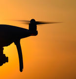 Quadrocopters silhouette against the background of the sunset Royalty Free Stock Image