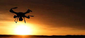 Quadrocopters silhouette in the background. radio-controlled toy royalty free stock image