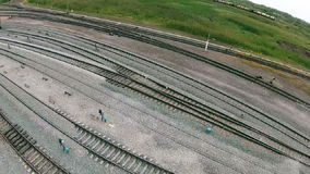 Quadrocopters takes the traveler on the train tracks freight train stock video footage