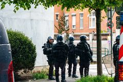 Quadron of police gerdarms officers secruing street. Strasbourg, France - Apr 28, 2019: Squadron of police gerdarms officers secruing entrance to Rue Rene stock photography