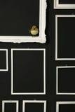 Quadros brancos sobre a parede preta Imagem de Stock Royalty Free