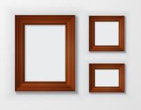 Quadros de madeira clássicos ajustados no fundo branco Fotografia de Stock Royalty Free