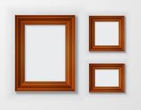 Quadros de madeira clássicos ajustados no fundo branco Foto de Stock