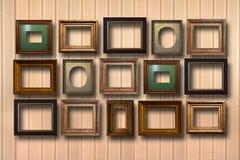 Quadros de madeira dourados para imagens no fundo Imagens de Stock Royalty Free