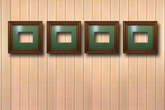 Quadros de madeira dourados para imagens no fundo Fotografia de Stock Royalty Free