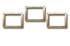 Quadros de madeira dourados para imagens no fundo isolado Foto de Stock