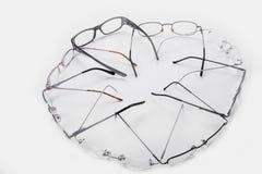 Quadros do plástico e do metal para vidros dioptrical no círculo Foto de Stock