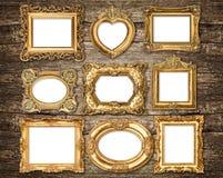Quadros dourados do estilo barroco sobre o fundo de madeira Obje antigo Imagens de Stock