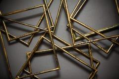Quadros dourados no fundo cinzento Imagem de Stock