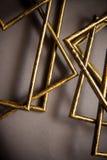 Quadros dourados no fundo cinzento Imagens de Stock