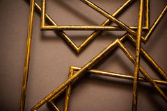 Quadros dourados no fundo cinzento Fotografia de Stock