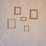 Quadros dourados no wal Imagem de Stock Royalty Free