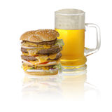 Quadruple cheeseburger and beer Stock Images
