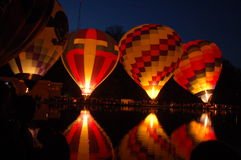 Quadruple Reflection on Mirror Lake. These hot air balloons reflect brightly on the rippled water of Mirror lake Royalty Free Stock Photography