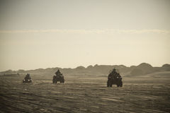 The 3 quads in the beach Stock Photo