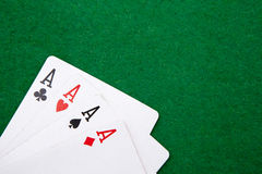 Quads on a green casino table Royalty Free Stock Images
