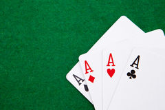 Quads on a green casino table Stock Photo