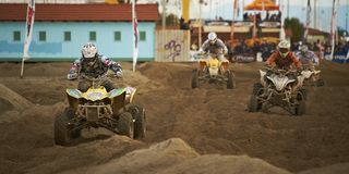 Quads at motocross race. Quad racing on the beach at F.I.F. race event on the October 2010 in Marina di Carrara, Tuscany, Italy Royalty Free Stock Images