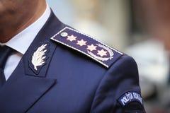 Quaestor-allmän gradbeteckning för polisen på epålett royaltyfri bild