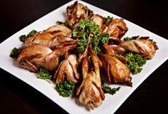 Quaglie cucinate con prezzemolo Fotografia Stock