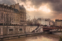 Quai de Montebello at sunset. Quai de Montebello, Seine River and Pont au Double at sunset. Paris. France Royalty Free Stock Photography