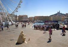 Quai du Port - street artist. Marseille harbor - Quai du Port - street artist and ferris wheel - France stock image