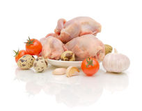 Quail carcasses, eggs and vegetables Royalty Free Stock Images