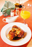 Quail carcasses stuffed with rice on a table Royalty Free Stock Photography