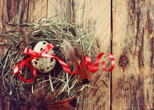 Quail easter egg with red ribbon Stock Photography